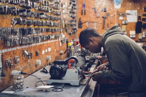 Craftsman at a workbench.