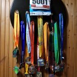 Wall display with dozen of running medals.